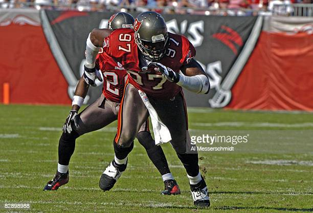Tampa Bay Buccaneers defensive end Simeon Rice rushes the passer at Raymond James Stadium in Tampa Florida November 21 2004 The Buccaneers defeated...