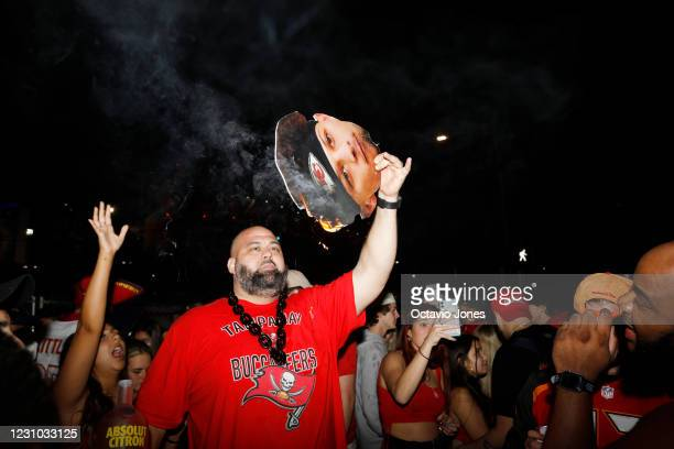 Tampa Bay Buccaneers fan burns a photo of Kansas City Chiefs quarterback Patrick Mahomes while celebrating during Super Bowl LV on February 7, 2021...