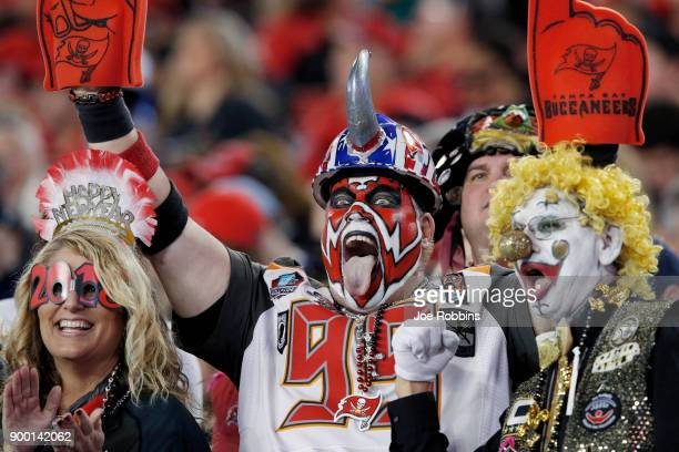 Tampa Bay Buccaneers fans celebrate in the second half of a game against the New Orleans Saints at Raymond James Stadium on December 31 2017 in Tampa...