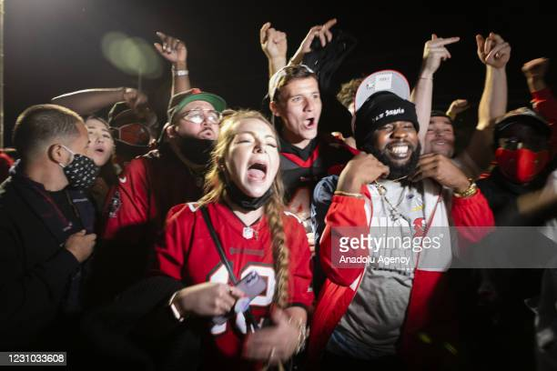 Tampa Bay Buccaneers' fans celebrate their victory outside Raymond James Stadium after winning the Super Bowl LV, in Tampa, Florida, United States on...
