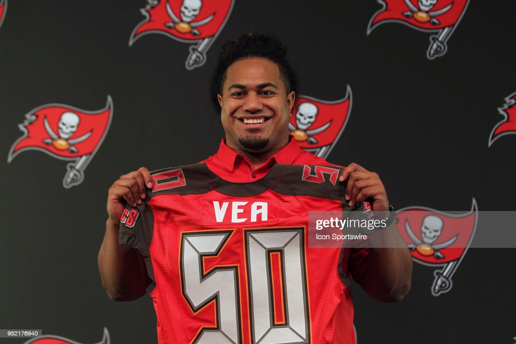 Tampa Bay Buccaneers first round pick out of University of Washington Vita Vea holds up his jersey for the gathered media on April 27, 2018 at One Buccaneer Place in Tampa, Florida.