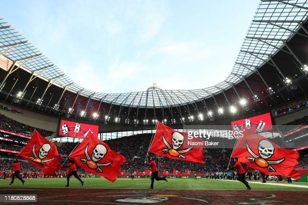 Tampa Bay Buccaneers flags are waved after they score a touch down during the NFL game between Carolina Panthers and Tampa Bay Buccaneers at...