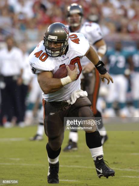 Tampa Bay Buccaneers fullback Mike Alstott rushes upfield at Raymond James Stadium in a preseason game August 28 2004 against the Miami Dolphins