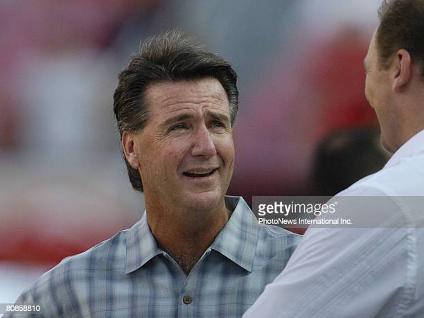Tampa Bay Buccaneers general manager Bruce Allen talks with former player Trace Armstrong at Raymond James Stadium in a preseason game August 28,...