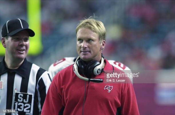 Tampa Bay Buccaneers head coach Jon Gruden right paces the sideline as referee John Parry speaks to him as they play the Atlanta Falcons in the...