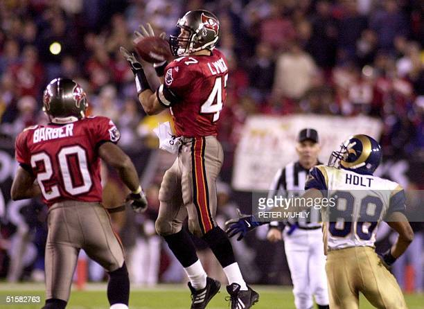 Tampa Bay Buccaneers John Lynch intercepts a pass intended for St Louis Rams Torry Holt 18 December 2000 in the fourth quarter at Raymond James...