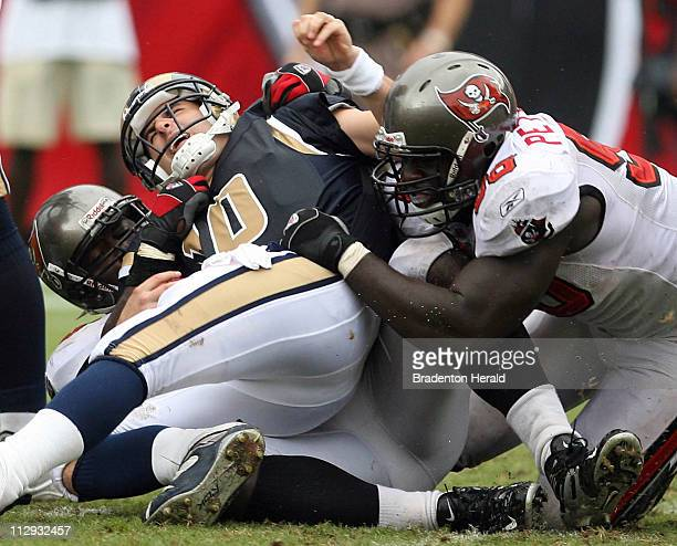 Tampa Bay Buccaneers Kevin Carter and Greg Peterson sack St Louis Rams quarterback Mark Bulger during the fourth quarter The Buccaneers defeated the...