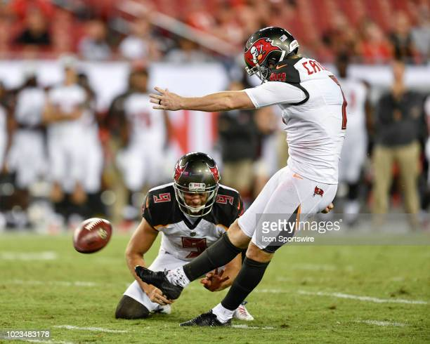Tampa Bay Buccaneers kicker Chandler Catanzaro kicks an extra point while Tampa Bay Buccaneers punter Bryan Anger holds during the second half of an...