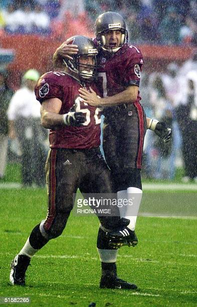 Tampa Bay Buccaneers' kicker Martin Gramatica celebrates with teammate Jeff Christy after he kicked what would be the game winning 46-yard field goal...