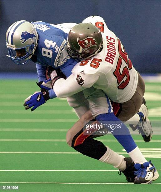 Tampa Bay Buccaneers' linebacker Derrick Brooks bring down Detroit Lions' wide receiver Herman Moore in the third quarter at the Silverdome in...