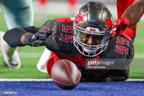 Tampa Bay Buccaneers linebacker Farrington Huguenin chases a fumbled ball during the preseason game between the Tampa Bay Buccaneers and Dallas...