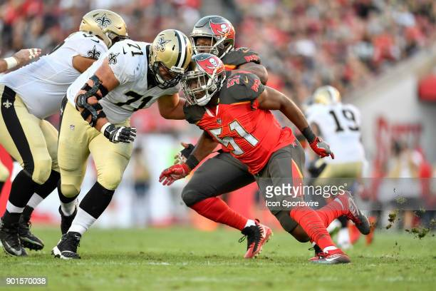 Tampa Bay Buccaneers linebacker Kendell Beckwith tries to get by the block by New Orleans Saints tackle Ryan Ramczyk during the first half of an NFL...