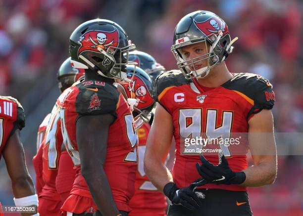 Tampa Bay Buccaneers outside linebacker Carl Nassib speaks with Tampa Bay Buccaneers linebacker Devante Bond during the first half of the season...