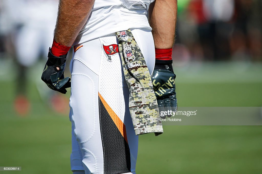 A Tampa Bay Buccaneers player wears the NFL Salute to Service towel on his waist while warming up before the game against the Chicago Bears at Raymond James Stadium on November 13, 2016 in Tampa, Florida.