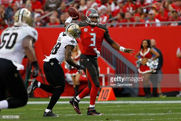 Tampa Bay Buccaneers quarterback Jameis Winston delivers a pass on the run before New Orleans Saints free safety Vonn Bell is able to get to him in...