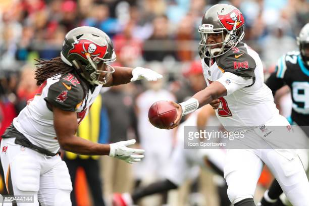 Tampa Bay Buccaneers quarterback Jameis Winston hands off to running back Doug Martin during the first half between the Tampa Bay Buccaneers and the...