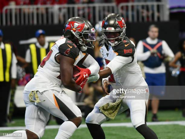 Tampa Bay Buccaneers Quarterback Jameis Winston hands off to Tampa Bay Buccaneers Running Back Peyton Barber during the NFL game between the Tampa...