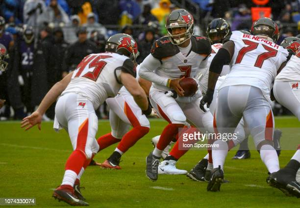 Tampa Bay Buccaneers quarterback Jameis Winston hands the ball off to tight end Alan Cross against the Baltimore Ravens on December 16 at MT Bank...