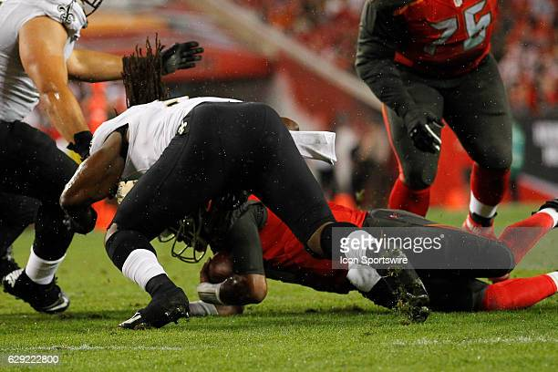Tampa Bay Buccaneers quarterback Jameis Winston is hit as he lays on the ground by New Orleans Saints outside linebacker Dannell Ellerbe in the 4th...