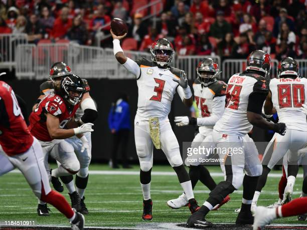 Tampa Bay Buccaneers Quarterback Jameis Winston passes the ball during the NFL game between the Tampa Bay Buccaneers and the Atlanta Falcons on...