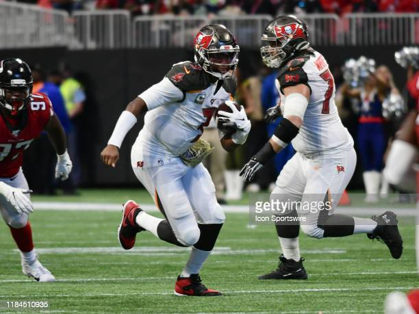 Tampa Bay Buccaneers Quarterback Jameis Winston rushes the ball during the NFL game between the Tampa Bay Buccaneers and the Atlanta Falcons on...