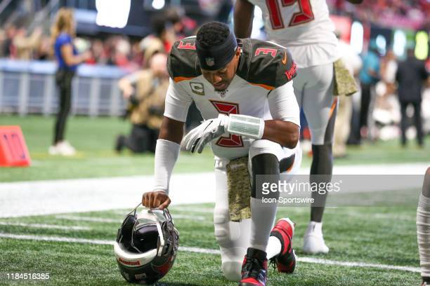 Tampa Bay Buccaneers quarterback Jameis Winston says a prayer before the NFL game between the Tampa Bay Buccaneers and the Atlanta Falcons on Nov...
