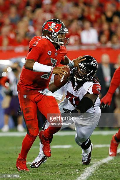 Tampa Bay Buccaneers quarterback Jameis Winston stiff arms Atlanta Falcons defensive tackle Courtney Upshaw to avoid being sacked in the 2nd quarter...