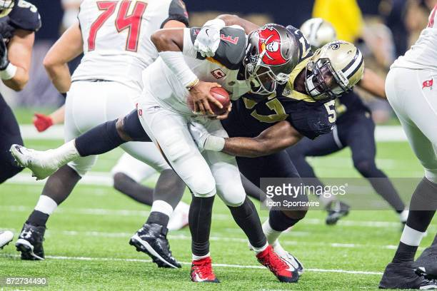 Tampa Bay Buccaneers quarterback James Winstons is sacked during a game between the Tampa Bay Buccaneers and New Orleans Saints at the Mercedes Benz...