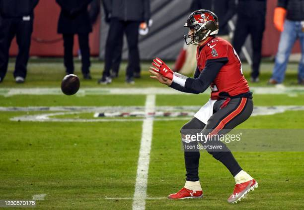 Tampa Bay Buccaneers quarterback Tom Brady takes the snap during the Tampa Bay Buccaneers Wild Card game versus the Washington Football Team on...