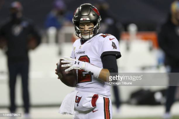 Tampa Bay Buccaneers quarterback Tom Brady warms up on the field before a game against Chicago Bears.
