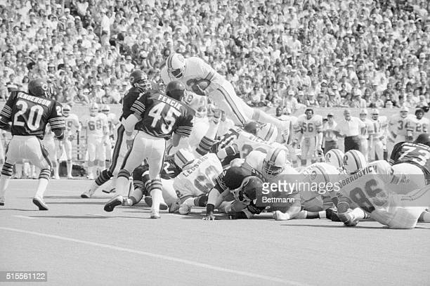 Tampa Bay Buccaneers' Ricky Bell goes up and over for a first down on the Chicago 27yardline in the first quarter of the game against the Chicago...