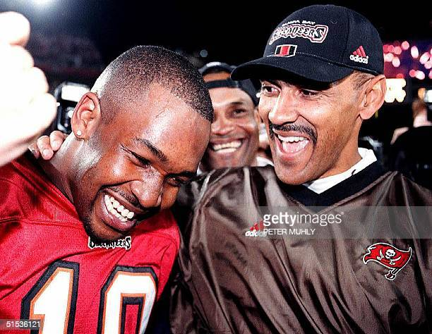 Tampa Bay Buccaneers' rookie quarterback Shawn King celebrates with Head coach Tony Dungy after defeating the Washington in the NFC playoffs at...