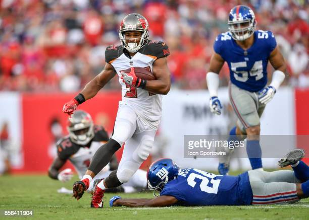 Tampa Bay Buccaneers running back Charles Sims III avoids the tackle by New York Giants cornerback Eli Apple during an NFL football game between the...