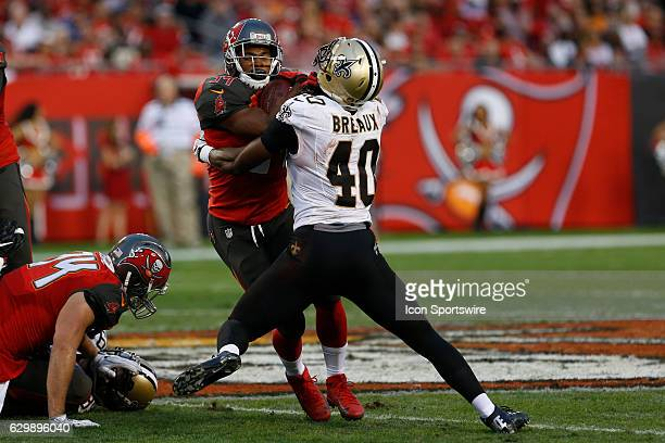 Tampa Bay Buccaneers running back Charles Sims is tackled by New Orleans Saints cornerback Delvin Breaux during the NFL game between the New Orleans...