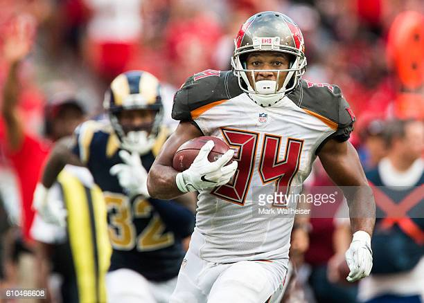 Tampa Bay Buccaneers running back Charles Sims lll sprints 60 yards ahead of Los Angeles Rams cornerback Troy Hill during the second half of their...