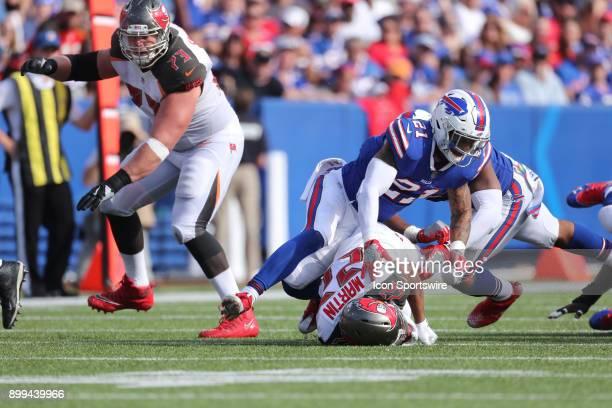 Tampa Bay Buccaneers running back Doug Martin is brought down by Buffalo Bills free safety Jordan Poyer and Buffalo Bills middle linebacker Preston...