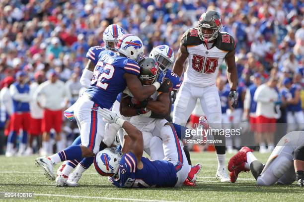 Tampa Bay Buccaneers running back Doug Martin is stopped by Buffalo Bills middle linebacker Preston Brown and Buffalo Bills outside linebacker...