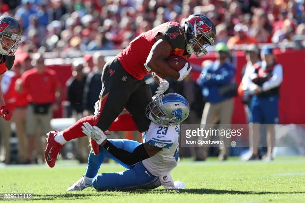 Tampa Bay Buccaneers running back Doug Martin is tackled by Detroit Lions cornerback Darius Slay in the first quarter of the NFL game between the...