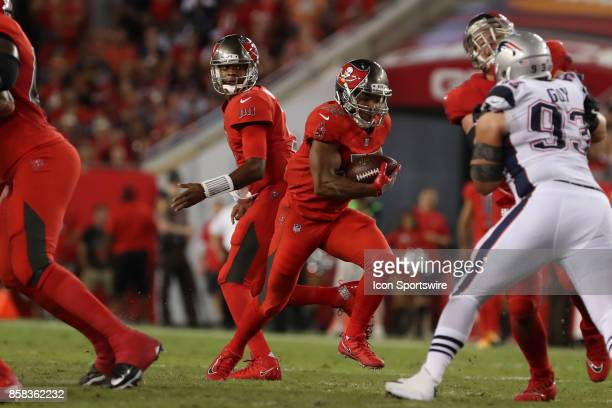 Tampa Bay Buccaneers running back Doug Martin takes a hand off from Tampa Bay Buccaneers quarterback Jameis Winston during the NFL game between the...