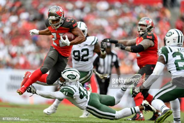 Tampa Bay Buccaneers running back Doug Martin tries to leap over the tackle by New York Jets cornerback Buster Skrine during the second half of an...