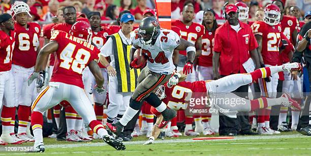 Tampa Bay Buccaneers running back Earnest Graham avoids the tackle by Kansas City Chiefs safety Sabby Piscitelli during secondquarter action in a...