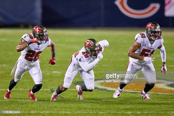 Tampa Bay Buccaneers Safety Andrew Adams , Tampa Bay Buccaneers Linebacker Cam Gill and Tampa Bay Buccaneers Linebacker Kevin Minter run in action...