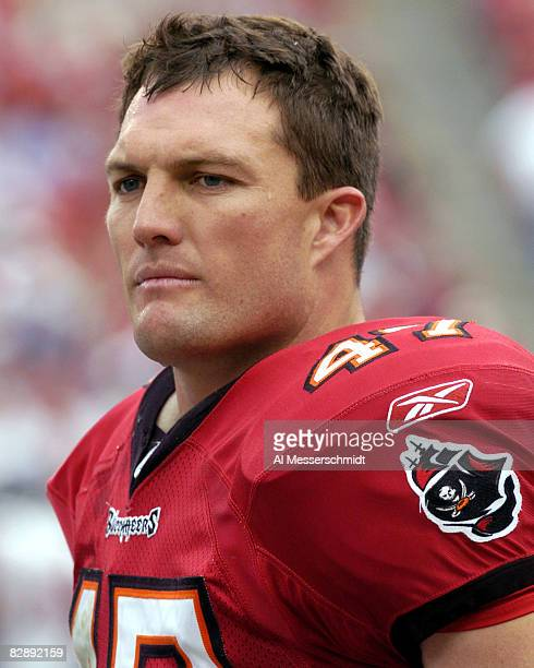 Tampa Bay Buccaneers safety John Lynch watches play against the Houston Texans at Raymond James Stadium Tampa Florida December 14 2003 The Bucs...