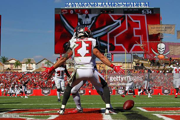 Tampa Bay Buccaneers strong safety Chris Conte runs into the end zone for a touchdown after intercepting a pass and then celebrates with his...
