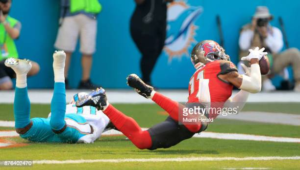 Tampa Bay Buccaneers strong safety Justin Evans intercepts the ball intended for Miami Dolphins wide receiver DeVante Parker in the end zone on...