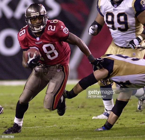 Tampa Bay Buccaneers Warrick Dunn breaks a tackle by St Louis Rams Todd Collins 18 December 2000 and runs for 52 yards for the gamewinning touchdown...
