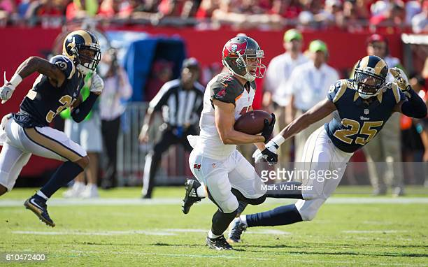 Tampa Bay Buccaneers wide receiver Adam Humphries runs after a reception as Los Angeles Rams Troy Hill and TJ McDonald pursue during the first half...