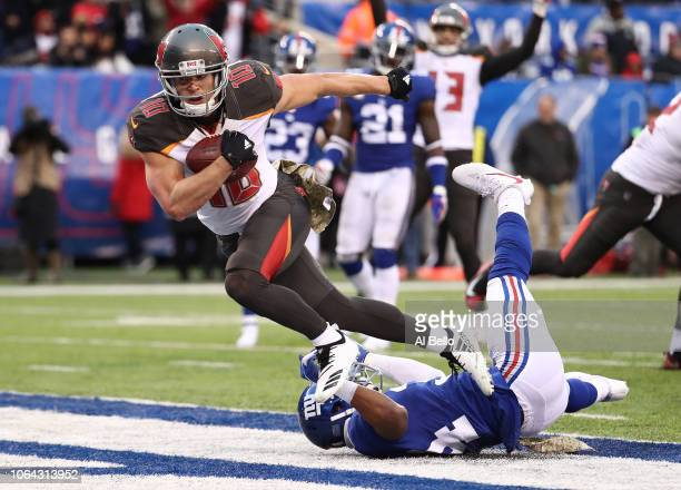 Tampa Bay Buccaneers wide receiver Adam Humphries scores a touchdown against New York Giants defensive back Grant Haley during their game at MetLife...