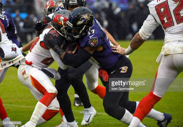 Tampa Bay Buccaneers wide receiver Bobo Wilson returns a kick off and is tackled by Baltimore Ravens running back Javorius Allen on December 16 at MT...