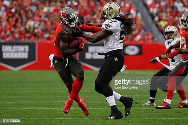 Tampa Bay Buccaneers wide receiver Josh Huff tries to break free from New Orleans Saints outside linebacker Dannell Ellerbe after catching a pass...